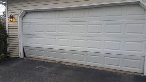 Aladin Garage Doors by Door Track Replacement