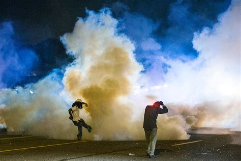 is gassy ferguson photos riot use tear gas to end protest against shooting of michael brown