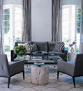living room with gray sofa charcoal gray couch transitional living room elle decor