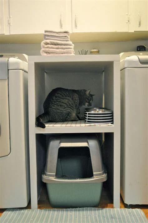 litter box in bedroom small laundry room with cat litter box