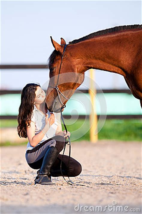 young girl  bay horse kiss royalty  stock images