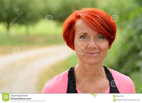middle age women with blue hair beautiful happy middle aged woman smiling stock photo