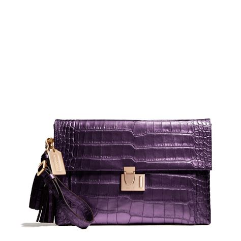 Clucth Coach coach legacy lock clutch in liquid metallic croc in purple lyst