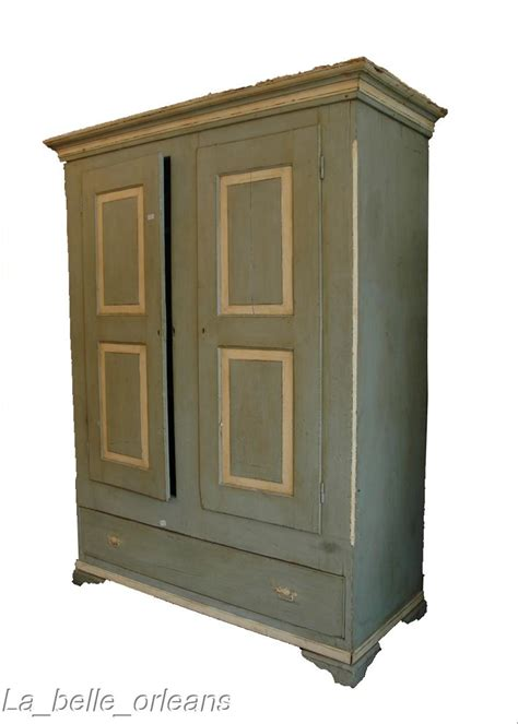 charming painted american primitive two door armoire for