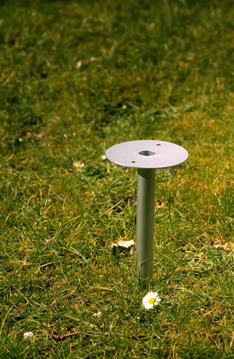 Lawn mounts for telescopic rods