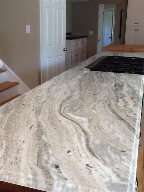 rocky mountain granite with white cabinets canyon dawn granite