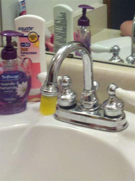 bathtub faucet extender cap from a lotion bottle as faucet extender since the