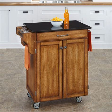 home styles large kitchen cart red black granite top home styles create a cart warm oak kitchen cart with black