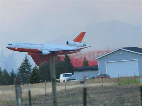 tanker 911 coming in low and for a drop firefighting aircraft in and as