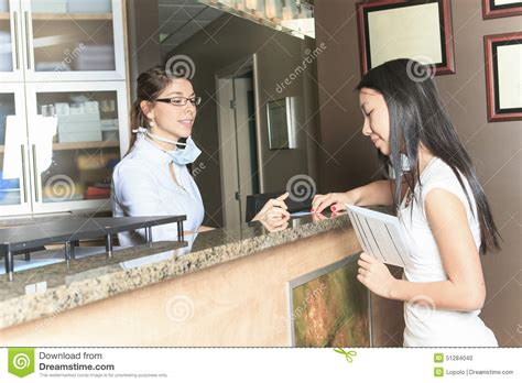 Dental Office Receptionist by Dental Assistance Receptionist Appointment Stock Photo Image 51284040