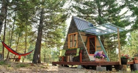 This solar powered A frame cabin features a retractable wall
