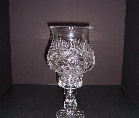 a resale glass candle holder with hurricane shade