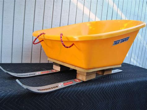 diy snow sled how to build a sled from a pair of skis and a