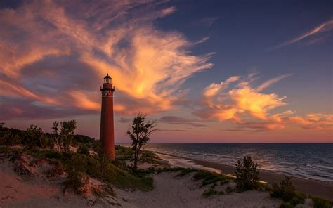 sunset lighthouse lake michigan sand wallpaper