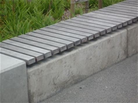 precast concrete benches timber slats situated onto a galvanised steel frame on top of a concrete precast