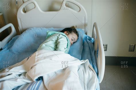 girl in hospital bed little girl sleeping in a hospital bed stock photo offset