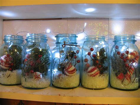 mason jars filled with christmas picks snow and lights