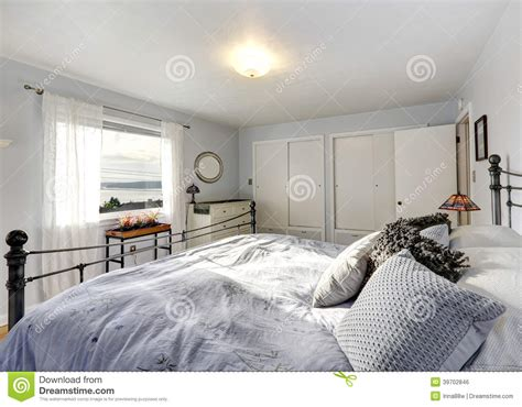 Fashioned Bedroom by Fashioned Bedroom With Iron Frame Bed Stock Photo