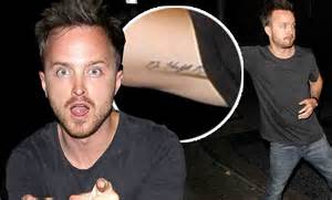 aaron paul tattoos aaron paul strikes a silly pose after a of partying