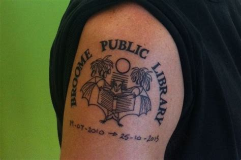 tattoo gallery adelaide librarian gets tattoo of broome library logo abc news