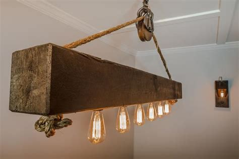 Rustic wood beam chandelier with Edison bulbs, rope and pulley