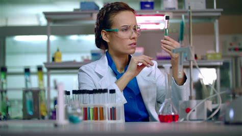 female chemist in laboratory chemist analyzing chemical