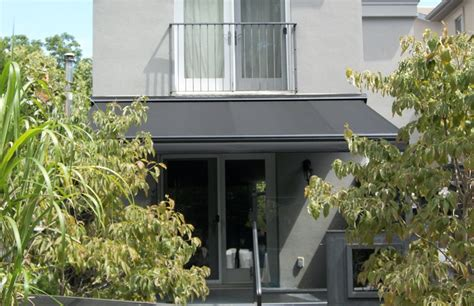 modern retractable awnings modern black on grey rolltec 174 retractable awnings