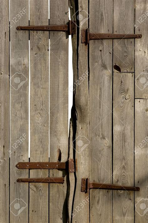 Rustic Barn Door Hinges Rustic Wooden Barn Door With Iron Hinges Stock Photo Picture And Barn Doors