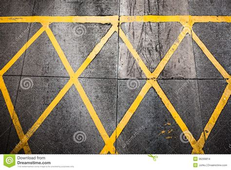 pattern of yellow lines on the roadway grungy yellow road paint pattern stock images image