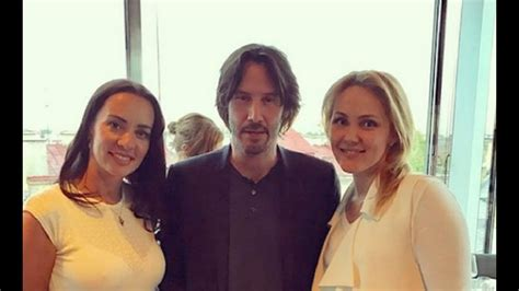 keanu reeves kenny omega keanu reeves with fans from all over the world part 4