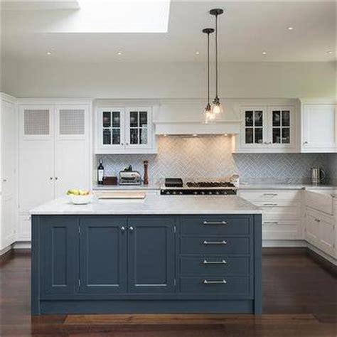Light Pendants Over Kitchen Islands white kitchen with blue island transitional kitchen