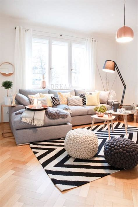 living room pouf how to make your living room a sociable space by kimberly