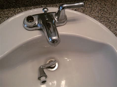 Replacing A Bathroom Faucet And Drain All About The House Remove Bathroom Faucet