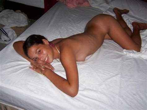 Cuban Escort Smiles Naked On The Bed