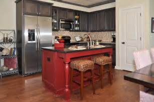 red kitchen island and dark