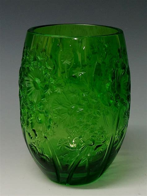 Lalique Green Vase by Lalique A Green Glass Vase The Moulded With Daisies