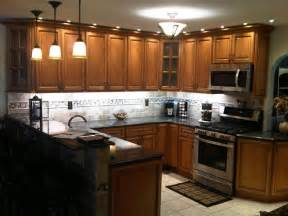light brown kitchen cabinets sandstone door
