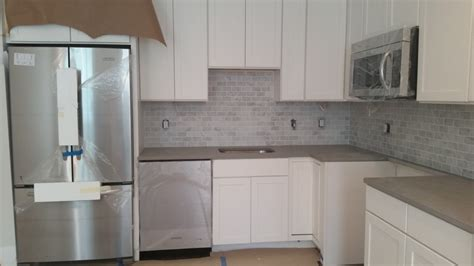 gray shaker kitchen cabinets with engineered white quartz 2323 40th st nw countdown to completion a washington