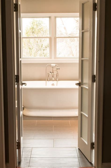 cool white double swing bathroom doors feat oval