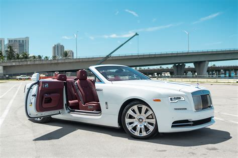 roll royce dawn rolls royce dawn white miami exotics exotic car rentals