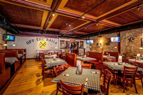 rustic eclectic dining room hardwood brick metal w dining room w tin ceilings brick walls and wood floors