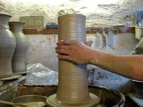 throwing a pot throwing a big clay pottery vase on a potters wheel