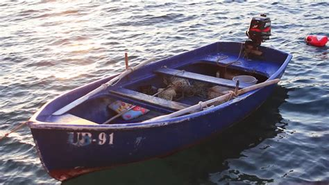 small boat fishing magazine small fishing boat floating on the water stock footage