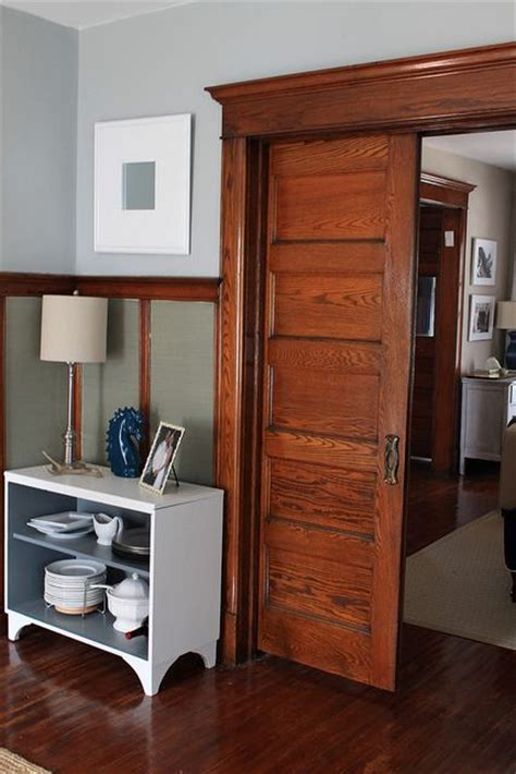 why i ll never paint our wood trim wood trim grey wood and pocket doors