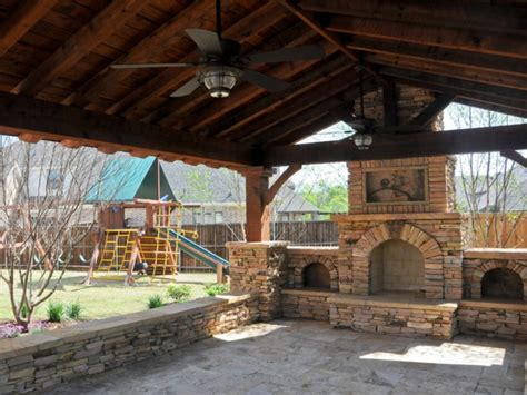 stone outdoor grill covered porch with fireplace patio