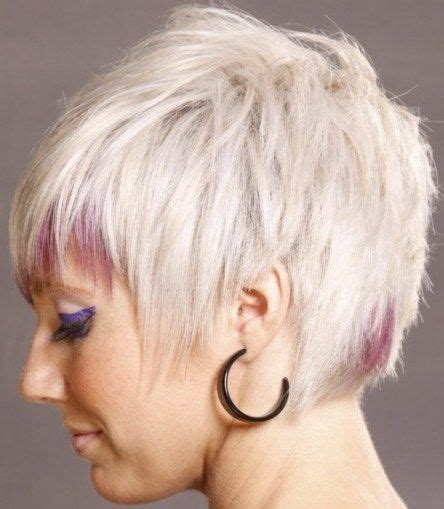 back of head asymettrical hair line cuts light blonde short hair pink highlights on bangs and back