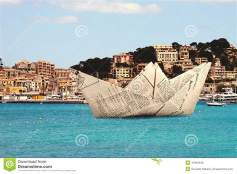Origami Floating Boat - paper origami boat floating in a water stock image image