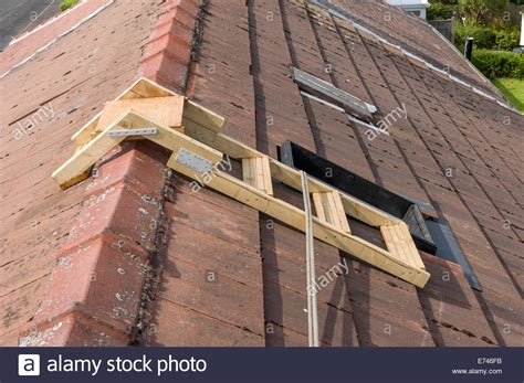 ladder on a roof a home made roof step ladder by a skylight window with