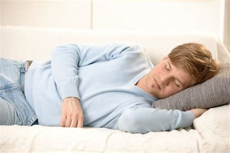 man sleeping on couch napping linked to early death study