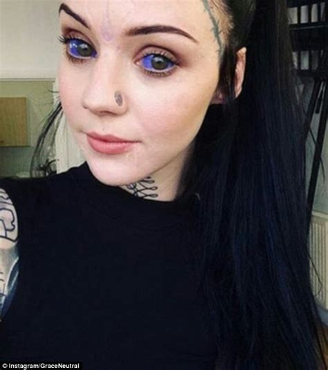 tattoo girl eyes grace neutral has her belly button cut off and blue ink